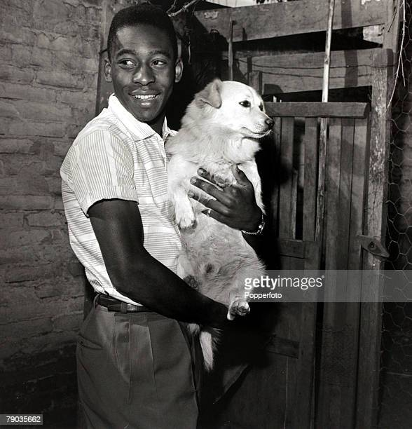 Sport Football circa 1958 Young Brazilian star Pele holding a dog Pele was perhaps the most famous footballer of all time and featured in 4 World...