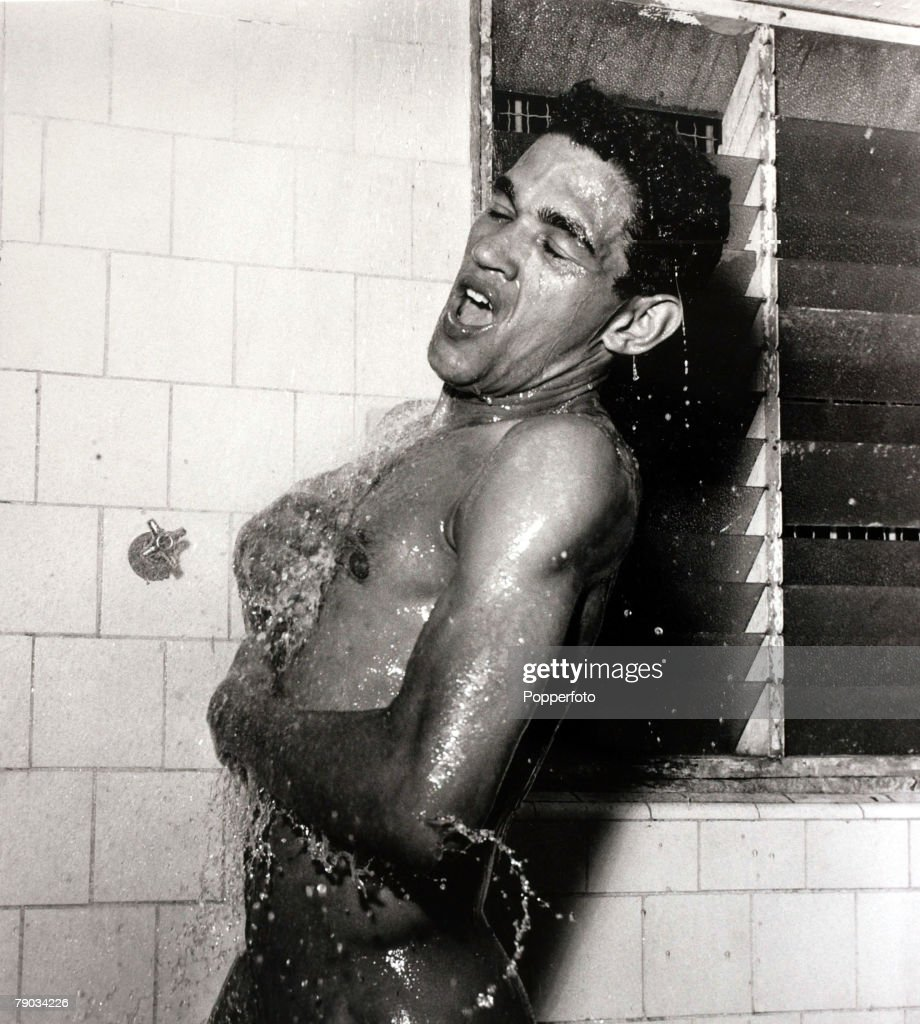Sport. Football. circa 1960. Brazil star Garrincha appears to be singing in the shower. He played 60 times for Brazil and with he and Pele in the team the national side never lost, his first international defeat occurred in his last game for Brazil in the : News Photo