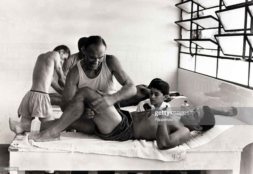 Sport. Football. circa 1960. Brazil star Garrincha receives treatment on his thigh. He played 60 times for Brazil and with he and Pele in the team the national side never lost, his first international defeat occurred in his last game for Brazil in the 196 : News Photo