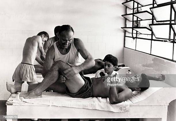 Sport Football circa 1960 Brazil star Garrincha receives treatment on his thigh He played 60 times for Brazil and with he and Pele in the team the...