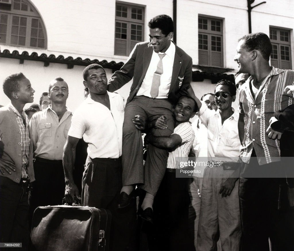 Sport. Football. circa 1962. Brazil star Garrincha is carried shoulder high as he receives a hero's welcome. He played 60 times for Brazil and with he and Pele in the team the national side never lost, his first international defeat occurred in his last g : News Photo