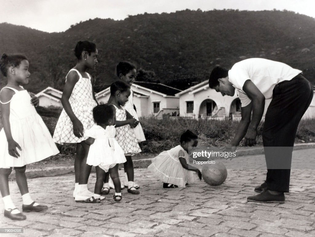 Sport. Football. circa 1965. Brazil star Garrincha with some of his daughters (he was the father of 7 daughters). He played 60 times for Brazil and with he and Pele in the team the national side never lost, his first international defeat occurred in his l : News Photo