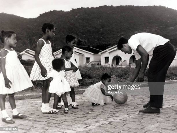 Sport Football circa 1965 Brazil star Garrincha with some of his daughters He played 60 times for Brazil and with he and Pele in the team the...