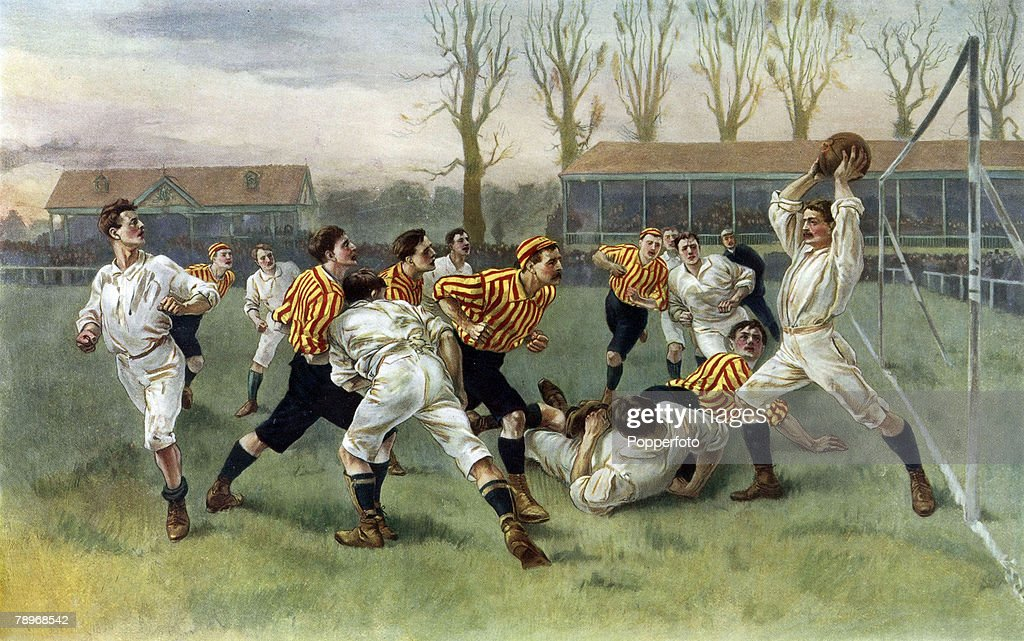 Sport. Football. Colour illustration. circa 1900.Sport. Football. 1890. Painting by W.A. Overend depicting a football match in which the goalkeeper (wearing the same colour jersey as his teammates) has caught the ball above his head, in an early game of A : News Photo