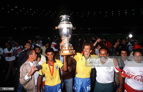Sport Football Copa America Maracana Rio de Janeiro Brazil 1 v Uruguay 0 Brazil's Valdo and Alemao are pictured with the trophy after their victory