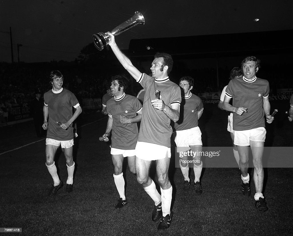 Sport, Football, Elland Road, England, 4th June 1971, Inter-City Fairs Cup Final, Second Leg, Leeds United 1 v Juventus 1 (Leeds win on away goals), Leeds United's Paul Reaney holds the trophy aloft after his sides aggregate victory, with L-R: Allan Clark : News Photo