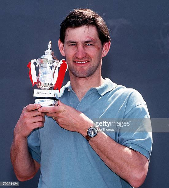 Sport Football England 1993 FA Cup Final Preview Arsenal captain Tony Adams holds a mini replica of the FA Cup trophy