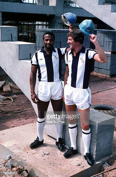 Sport Football England 21st July 1980 West Bromwich Albion's Cyrille Regis and John Wile are pictured on the site of the new stand which is under...