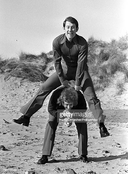 Sport, Football, England Howard Kendall is pictured leap-frogging over former Everton FC team-mate John Connolly on the beach at Southport