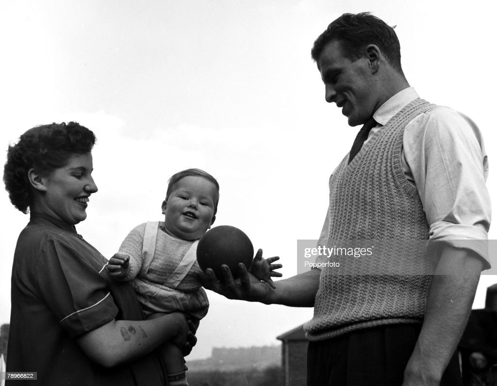 Sport. Football. England. 1955. John Charles of Leeds United and Wales is pictured with his wife Peggy and 15 month old son Terence. : News Photo