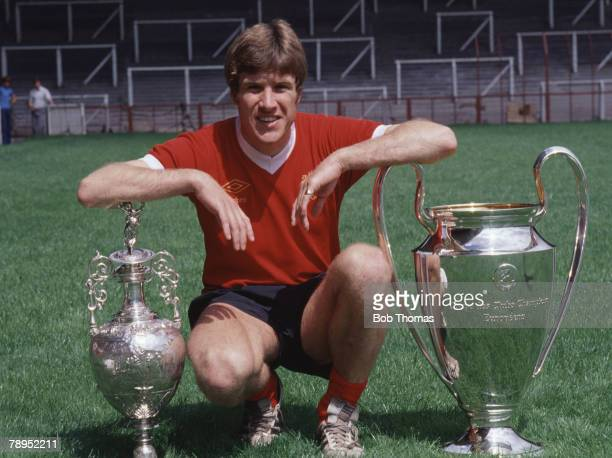 Sport Football England Liverpool captain Emlyn Hughes with the English League Championship trophy and the European Cup
