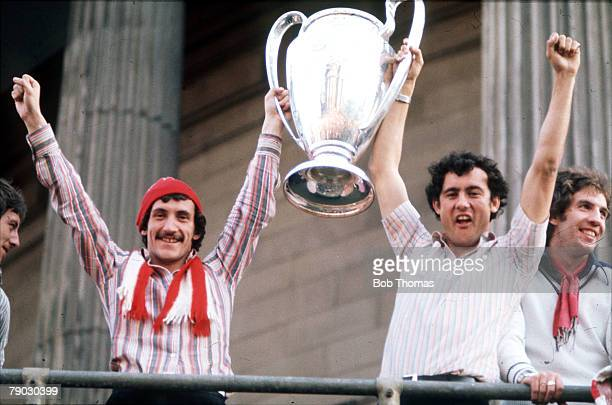 Sport Football England Liverpool FC's Terry McDermott and Ray Kennedy show the European Cup trophy to their fans at Liverpool Town Hall after their...