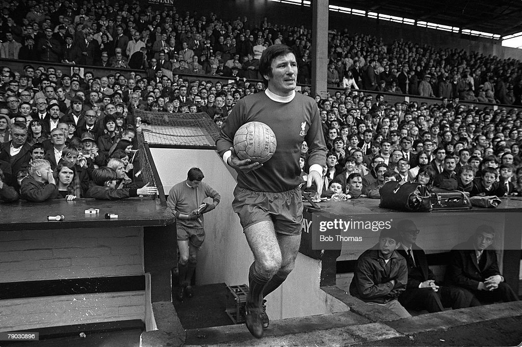 Sport. Football. England. 1969. Liverpool FC's Tommy Smith runs out onto the pitch at Anfield. : News Photo