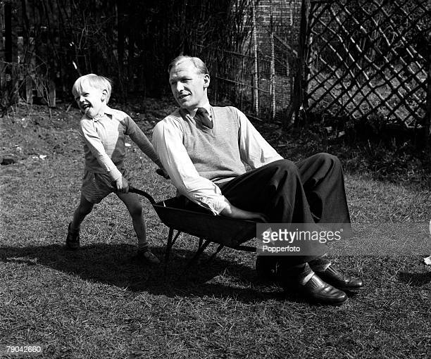 Sport Football England Manchester City goalkeeper Bert Trautmann is pictured being pushed in a wheelbarrow by his four year old son John