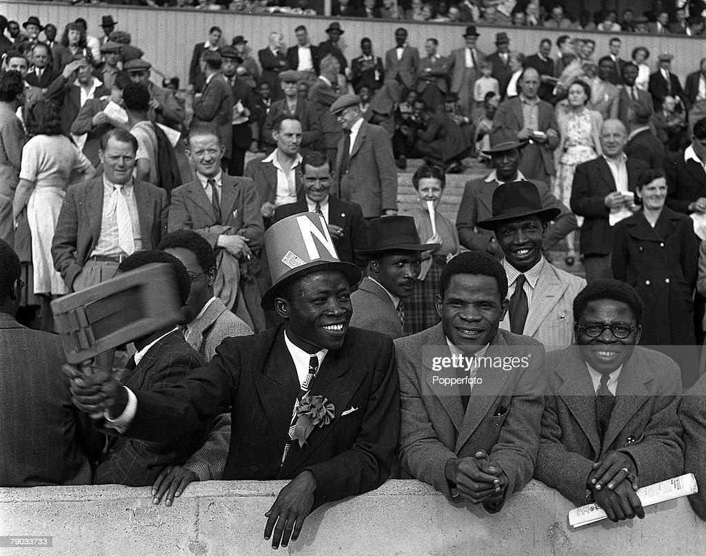 Sport. Football. England. 1949. Supporters for the Nigeria football team who are playing in England for the first time are pictured enjoying a match. : News Photo