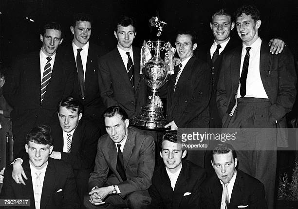 Sport Football England The Manchester United team are pictured with the League Championship trophy at the civic reception given in their honour Back...