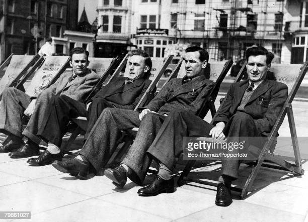Sport Football England's LR Eddie Lowe Billy Wright Neil Franklin and JImmy Mullen relaxing in deck chairs on Brighton seafront prior to England's...