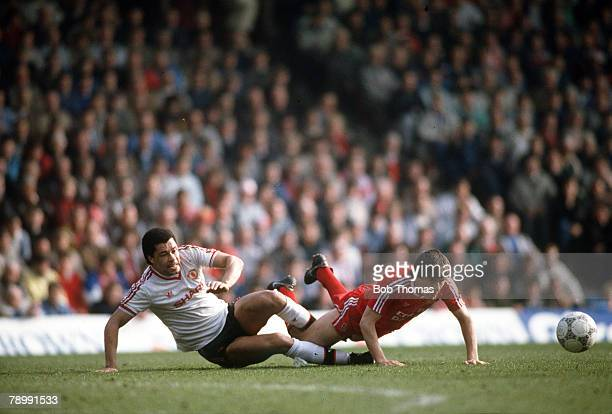 Sport Football English League Division One 4th April 1988 Liverpool 3 v Manchester United 3 United's Paul McGrath brings down Liverpool's Peter...