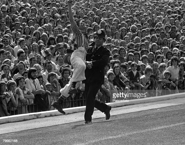 Sport Football English League Division One London England 25th August 1973 Arsenal v Manchester United A policeman removes a fan prior to the match...