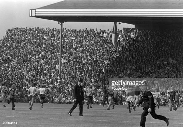 Sport Football English League Division One London England 25th August 1973 Arsenal v Manchester United Helpless policemen face a hopeless task of...