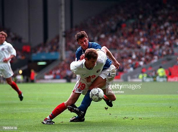 Sport Football European Championship 11thJune 1996 Italy 2 v Russia 1 Russia's Vladislav Radimov clashes with Italy's Alessandro Del Piero