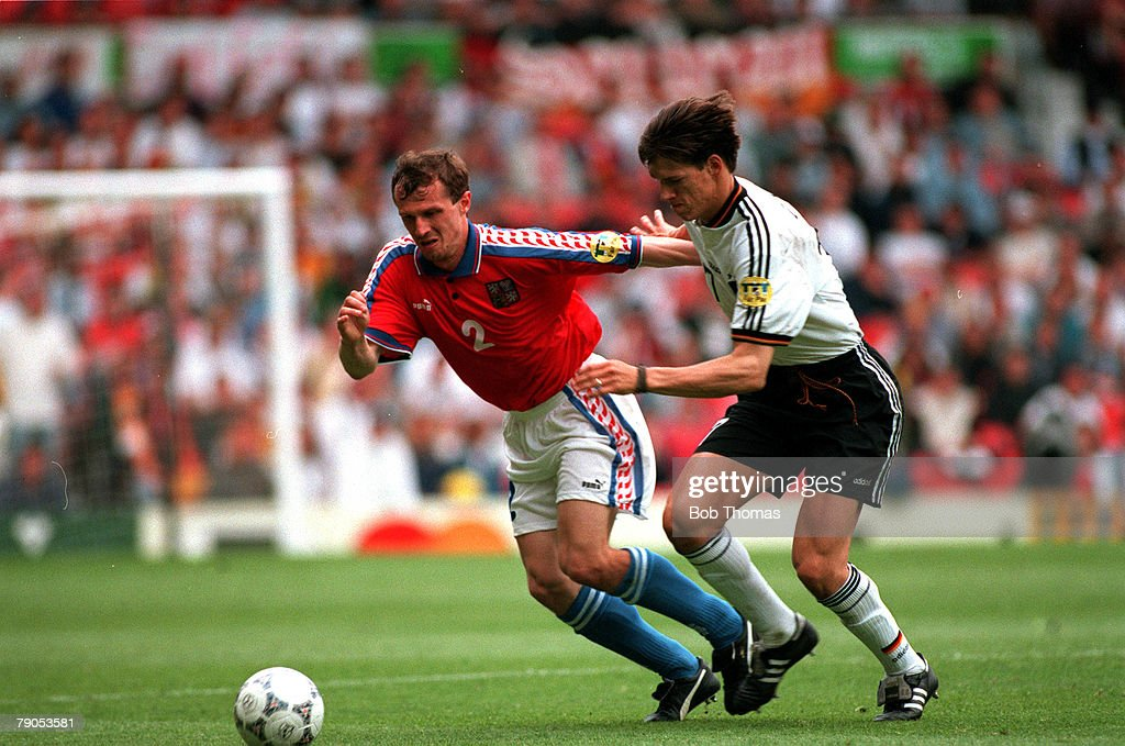 Sport, Football, European Championships, 9th. June, 1996. Germany 2 v 0 Czech. Republic. (Old Trafford). Germany's Christian Ziege (right) competes with Czech. Republic's Radek Latel for the ball. : News Photo
