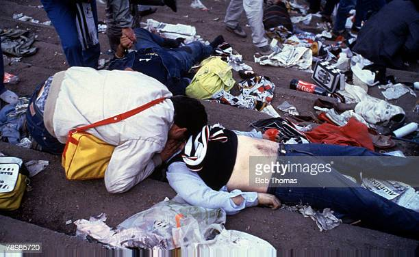 Sport Football European Cup Final Brussels 29th May 1985 Liverpool 0 v Juventus 1 A Juventus supporters tries to give the kiss of life to a injured...