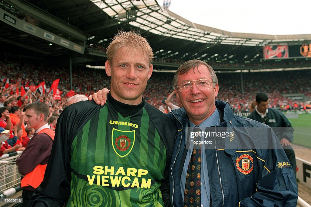 Sport. Football. FA Charity Shield. Wembley, London, England. 3rd August 1997. Manchester United 1 v Chelsea 1 (Manchester United win 4-2 on penalties). Manchester United Manager Alex Ferguson (right) congratulates his goalkeeper Peter Schmeichel after th : News Photo