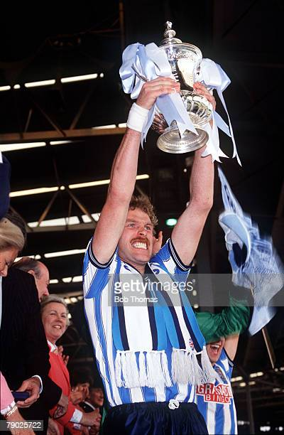 Sport Football FA Cup Final Wembley London England 16th May 1987 Coventry City 3 v Tottenham Hotspur 2 Coventry City captain Brian Kilcline holds the...