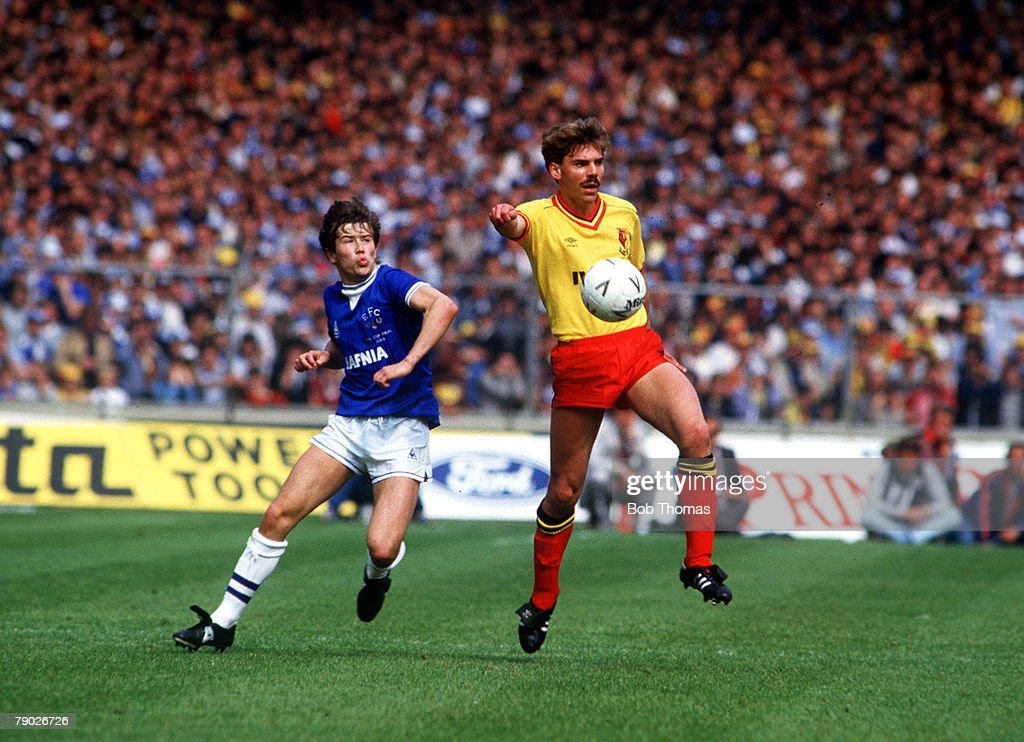 Sport. Football. FA Cup Final. Wembley, London, England. 19th May 1984. Everton 2 v Watford 0. Watford's Paul Atkinson holds off Everton's Adrian Heath. : News Photo