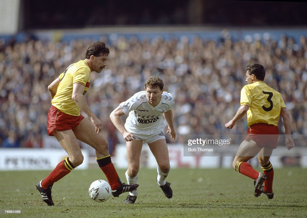 Sport. Football. FA Cup Semi-Final at Villa Park. Tottenham Hotspur 4 v Watford 1. pic: 11th April 1987. Tottenham Hotspur's Clive Allen centre, and Watford pair Steve Sims, left and Wilf Rostron keep watch on the ball. : News Photo