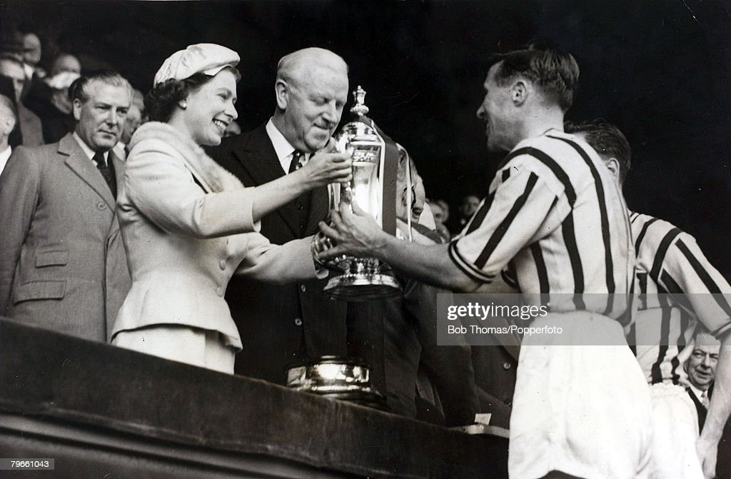 Sport, Football, F,A,Cup Final, Wembley, London, England, 4th May 1957, Aston Villa 2 v Manchester United 1, Aston Villa captain Johnny Dixon receives the F,A,Cup trophy from H,M,Queen Elizabeth II watched by Sir Stanley Rous : News Photo