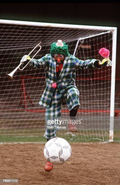 circa 1990 Liverpool's Bruce Grobbelaar in typical extrovert behaviour as he dresses up as a clown complete with trumpet flower and football