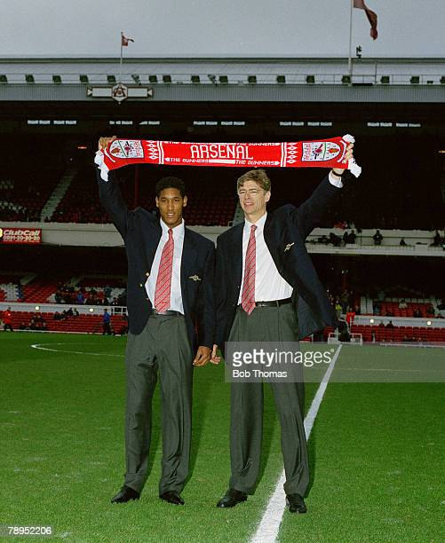 Sport, Football, February 1997, Highbury, London, England, Arsenal manager Arsene Wenger introduces his new signing Nicolas Anelka to the fans
