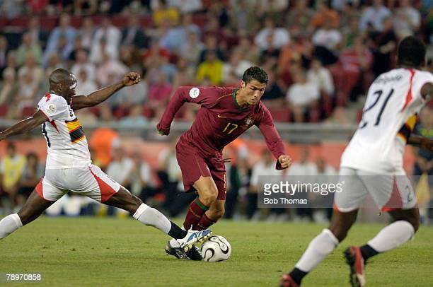Sport Football FIFA World Cup Cologne 11th June 2006 Angola 0 v Portugal 1 Portugal's Cristiano Ronaldo centre takes on the Angola defence
