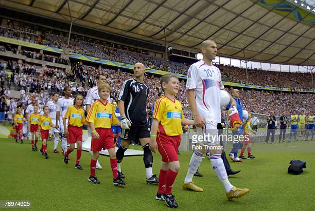 Sport Football FIFA World Cup Final Berlin 9th July 2006 Italy 1 v France 1 Italy won 53 on Penalties The French team and the mascots are led out by...