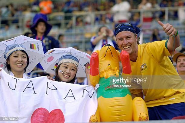 Sport Football FIFA World Cup Kaiserslautern 12th June 2006 Australia 3 v Japan 1 Harmony between rival fans as two Japanese girls and an Australian...