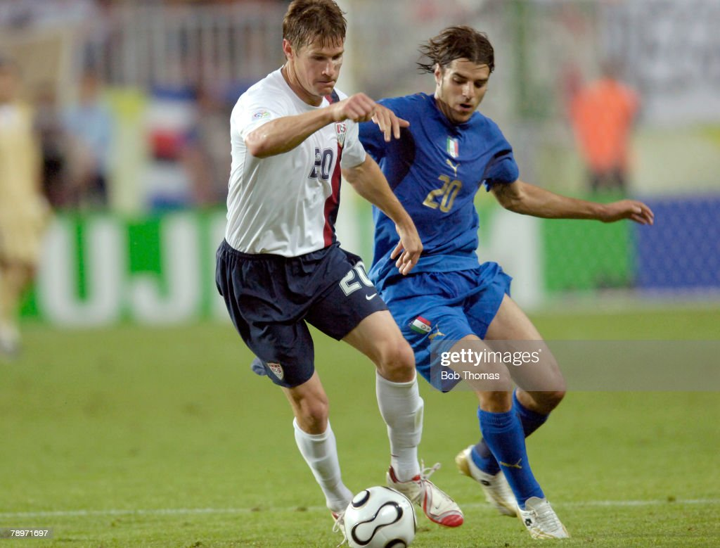 Sport, Football, FIFA World Cup, Kaiserslautern, 17th June 2006, Italy 1 v USA 1, USA's Brian McBride is challenged by Italy's Simone Perrotta, right