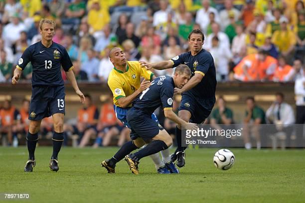 Sport, Football, FIFA World Cup, Munich, 18th June 2006, Brazil 2 v Australia 0, Brazil's Ronaldo has his path blocked by Australia's Scott...