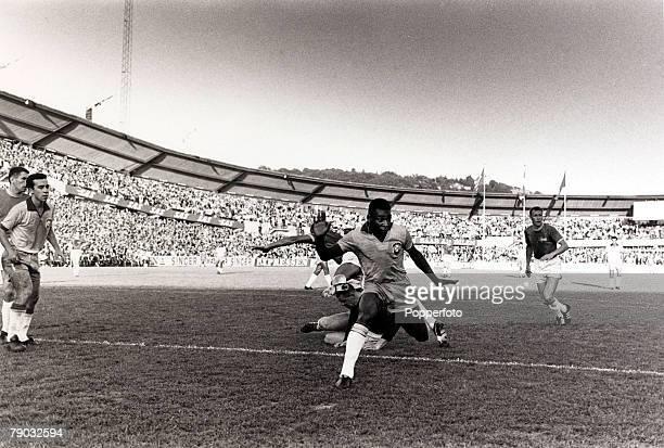 Sport Football Friendly International Gothenburg 30th June 1966 Sweden 2 v Brazil 3 Brazil's Pele leaves the Sweden defence in a tangle as he bears...