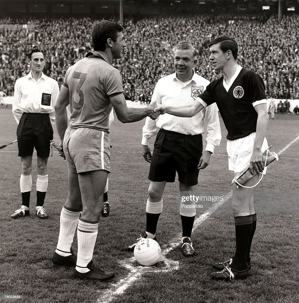 Sport. Football. Friendly International. Hampden Park, Glasgow. 25th June 1966. Scotland 1 v Brazil 1. Brazil captain Bellini (left) is greeted by Scotland captain John Greig as referee Jim Finney looks on. : News Photo