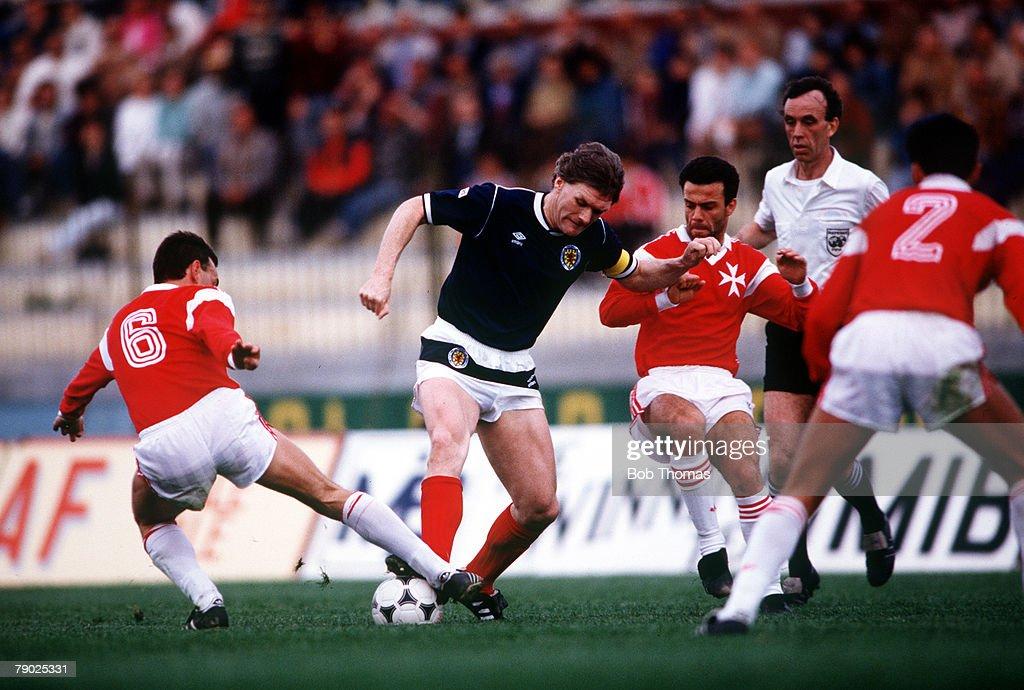 Sport. Football. Friendly International. Valetta. 22nd March 1988. Malta 1 v Scotland 1. Scotland's Roy Aitken takes on the Malta defence. : News Photo