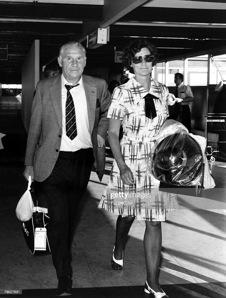 Sport, Football, Heathrow, London, England, 30th May 1974, Tottenham Hotspur manager Bill Nicholson with his wife Darkie, arrive at Heathrow from Holland after losing their UEFA Cup final 2-0 against Feyenoord in the 2nd leg, Spurs lost 4-2 on aggregate