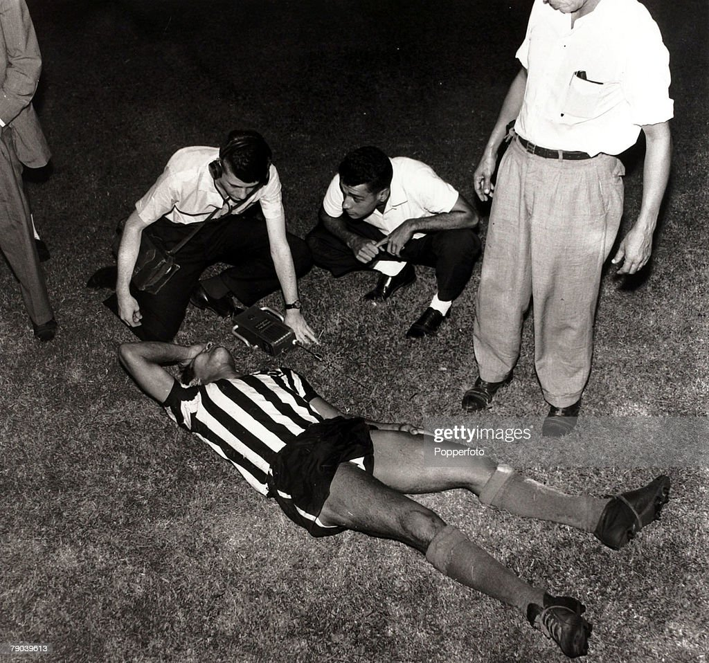 Sport. Football in South America. circa 1960. Botafogo's Garrincha flat out after a game while reporters wait for an interview. : News Photo