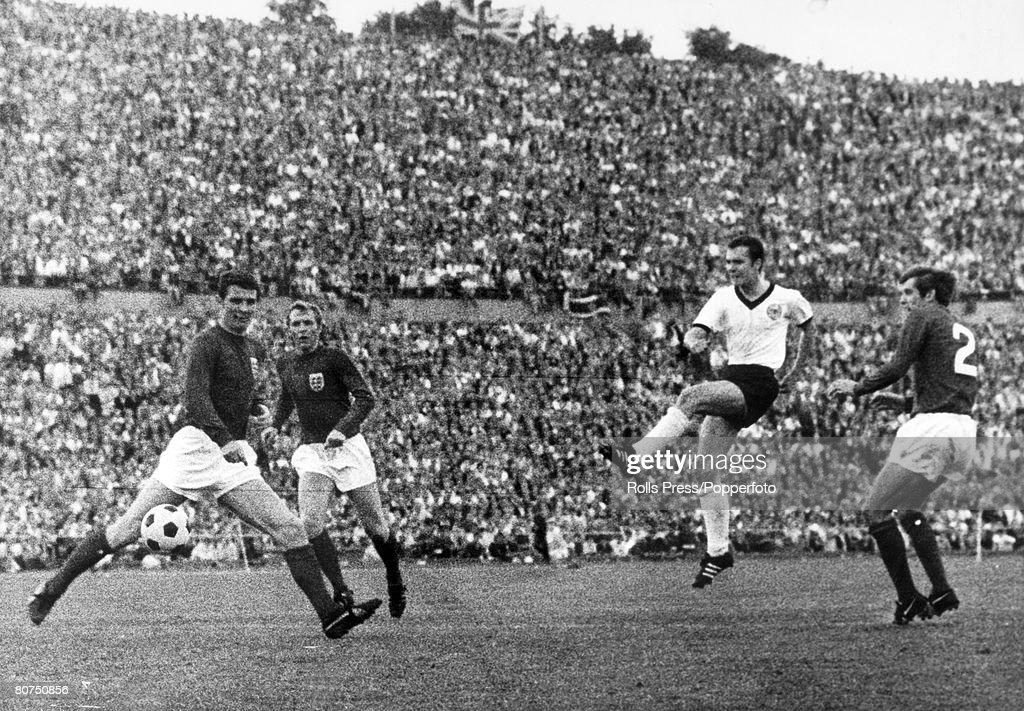 Sport Football. International Match in Hanover. West Germany 1 v England 0. West Germany's Franz Beckenbauer scores the winning goal as he shoots past England defenders left-right, Brian Labone, Bobby Moore and Keith Newton. : News Photo