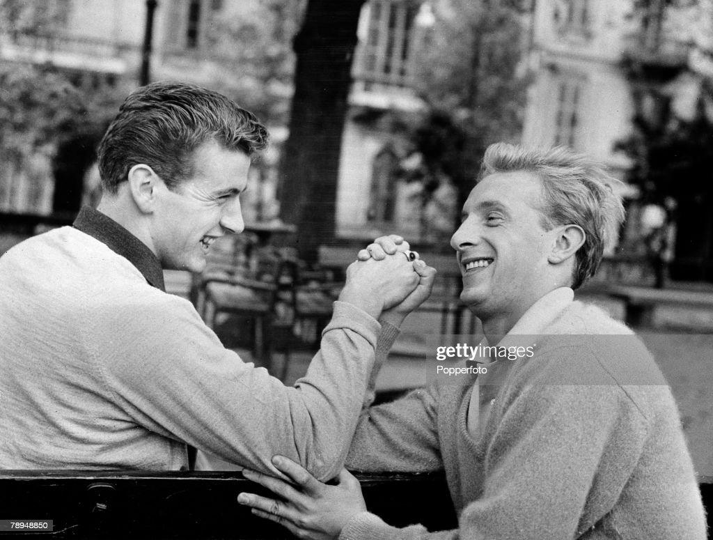 Sport, Football, Italy, 22nd February 1962, Scottish footballer's Joe Baker ( left) and Denis Law having a game of arm wrestling, Both players play for Italian club Torino