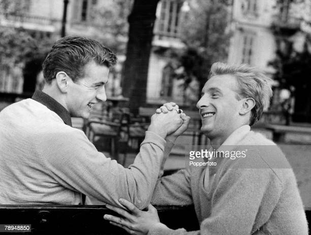 Sport Football Italy 22nd February 1962 Scottish footballer's Joe Baker and Denis Law having a game of arm wrestling Both players play for Italian...