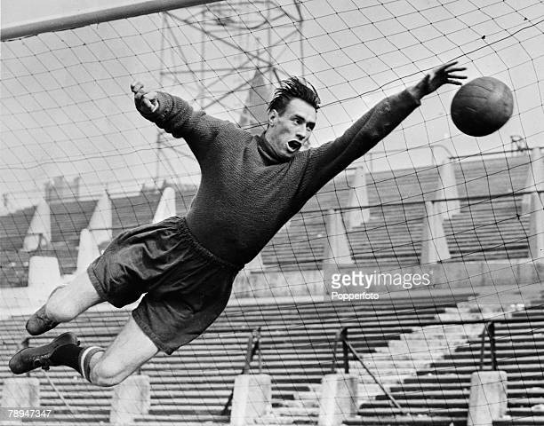 Sport Football January 1958 Manchester United goalkeeper Ray Wood dives to catch the ball during a training session