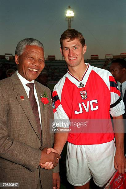 Sport Football Johannesburg South Africa July 1993 Arsenal captain Tony Adams shakes hands with Nelson Mandela