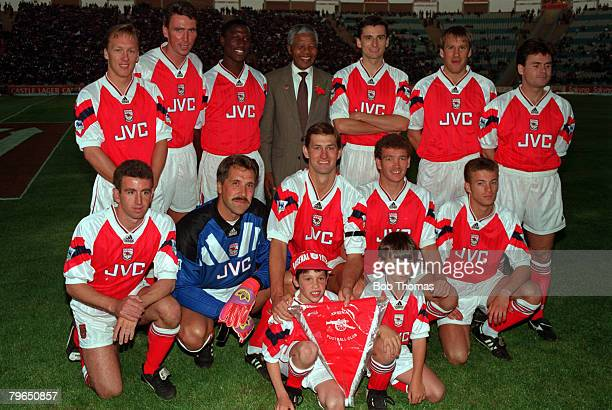Sport Football Johannesburg South Africa July 1993 The Arsenal team line up together for a group photograph with Nelson Mandela Back Row LR Lee Dixon...
